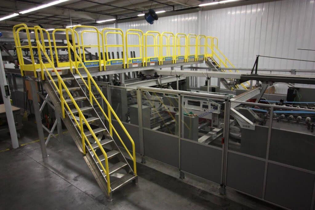 Erectastep raised walkway service platform in manufacturing environment